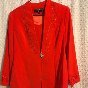 Women's red suit with skirt.